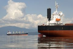 Freighters. Two empty freighters anchored off the west coast of North America stock photo