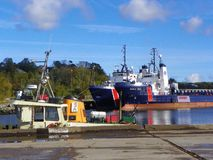 Freighters at the dry dock. Freighters and tug boats near the dry dock Royalty Free Stock Images