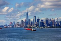 Freighters in Harbor with New York City in Background Stock Image