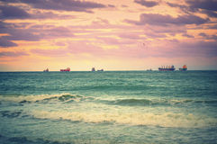 Freighters on horizon Stock Image