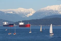 Freighters and Sailboats, English Bay, Vancouver Stock Images