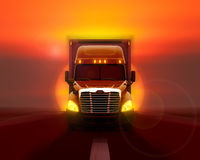 Freightliner columbia truck moving fast on the road. Freightliner columbia truck moving fast on the road against the setting sun Royalty Free Stock Images