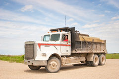 Freightliner truck. A Freightliner truck on a gravel road in Kansas Royalty Free Stock Photo