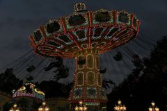 Freimarkt, Bremen,Germany, April 14th, 2017: Fast ride on an illuminated chairoplane with high flying chairs. On Freimarkt fair stock images
