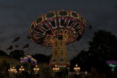 Freimarkt, Bremen,Germany, April 14th, 2017: Fast ride on an illuminated chairoplane with high flying chairs. On Freimarkt fair stock photo