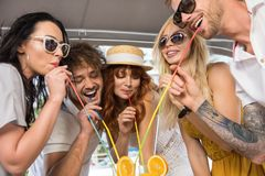 Freinds are drinking cocktails on yacht stock photos