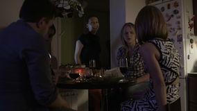 Freinds gathering together at home in the evening stock footage