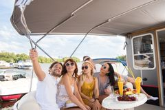 Freinds are making selfie on yacht royalty free stock images
