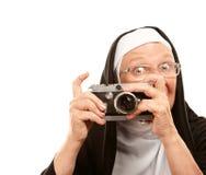 Freira com câmera velha fotografia de stock