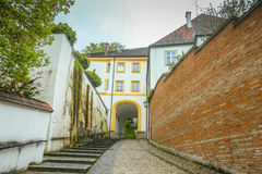 Freising Cathedral. FREISING, GERMANY - MAY 8, 2017 : A view of the romanesque building with entrance to Domberg and basilica Saint Mary and Corbinian Cathedral Stock Images
