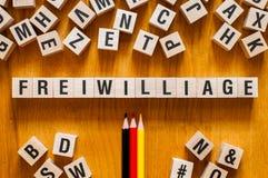 Freiwilliage -德语的,词概念词志愿者 免版税库存照片