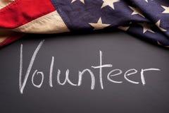 Freiwilliges Zeichen auf einer Tafel Lizenzfreies Stockfoto
