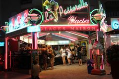 FREJUS PORT, PROVENCE, FRANCE - JUNE 20 2016: Customers waiting under the neon lights of an ice cream stall. stock images