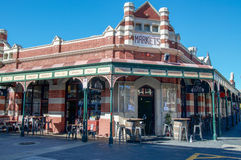 Fremantle Markets and Eatery. FREMANTLE,WA,AUSTRALIA-JUNE 1,2016: Fremantle Markets limestone and brick architecture with outdoor eatery setting under a blue sky Royalty Free Stock Photo
