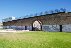 Fremantle Prison: Boundary Guard Tower. FREMANTLE,WA,AUSTRALIA-JUNE 1,2016: The historic limestone Fremantle Prison exterior walls with boundary guard tower in stock photography