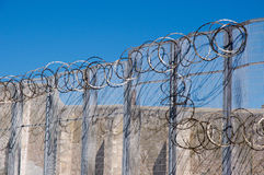 Fremantle Prison's Razor Wire. FREMANTLE,WA,AUSTRALIA-JUNE 1,2016: Sharp razor wire at the Fremantle Prison with fence under a blue sky in Fremantle, Western Stock Images
