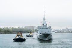 FREMM Languedoc & Svitzer Cartier tugboat Royalty Free Stock Photo
