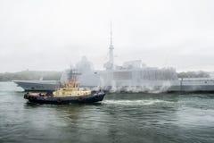 FREMM Languedoc & Svitzer Cartier tugboat Stock Photos
