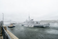 FREMM Languedoc & Svitzer Cartier tugboat. The FREMM multi-mission frigate Languedoc in fog carried out a four-day port visit in Montréal from September Stock Photos