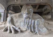 The Fremont Troll, a colossal statue under the north end of the George Washington Memorial Bridge in Seattle, Washington. Pictured is The Fremont Troll also royalty free stock photo