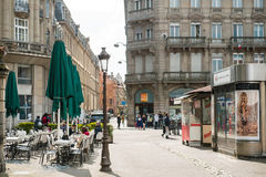 Frenc Place with cafe and press and buildings Stock Photography