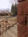 Frence & Steps. Corner of bricks with septs and fence Stock Image