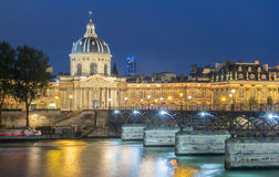 The French Academy et pont des Arts at night , Paris, France. Royalty Free Stock Photos
