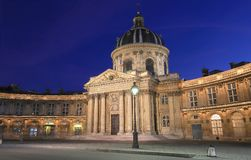 The French Academy at night , Paris, France. The French Academy is pre-eminent French council for matters pertaining to the French language.It was established stock photo