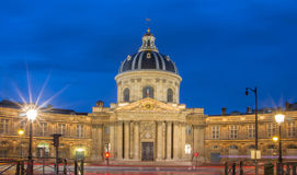 The French Academy at night , Paris, France. Royalty Free Stock Image
