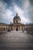 French Academy in Paris, France. French Academy and Passerelle des Arts in Paris, France royalty free stock photo