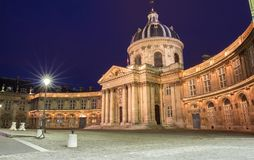 The French Academy at night , Paris, France. The French Academy is pre-eminent French council for matters pertaining to the French language.It was established royalty free stock photo