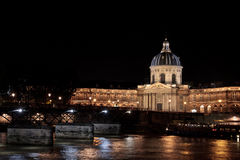 French academys and the Seine. Front view of the French academy of Paris (France) by night Stock Photography