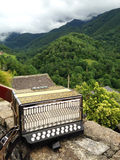 French accordion. With Pyrenees mountains background Stock Image