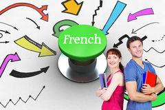 French against digitally generated green push button. The word french and two students both with notepads against digitally generated green push button Royalty Free Stock Images