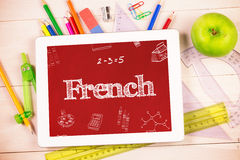 French against students desk with tablet pc Stock Photo