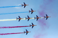 French Air Force at Le Bourget Air Show 2009. PARIS - JUNE 21: French Airforce 'Patrouille de France' performs its flying demonstration at Le Bourget Air Show on Royalty Free Stock Photos