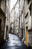 French alley in Montpellier. Alley in the small french historic old town Montpellier stock photography