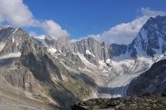 French alps. Petites jorasses (c), and grandes jorasses (r) with the aiguille du telefre hidden in the clouds in the french alps above chamonix Royalty Free Stock Photography