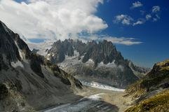French Alps. The 'aiguilles de chamonix' or the chamonix needles, above the mer de glace in the french alps, viewed from above the leschaux glacier Royalty Free Stock Photo