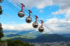 French Alps and Grenoble-Bastille cable car, France. Picturesque view of French Alps and Grenoble-Bastille cable car in summer, France stock images