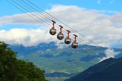 French Alps and Grenoble-Bastille cable car, France. Picturesque view of French Alps and Grenoble-Bastille cable car in summer, France Stock Photo