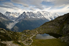 French Alps  - Mont Blanc. Views of French Alps - small pond with mountains in the background Stock Photo