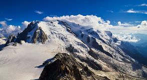 French Alps, Mont Blanc and glaciers as seen from Aiguille du Midi, Chamonix, France. French Alps, Mont Blanc and glaciers as seen from Aiguille du Midi Royalty Free Stock Images