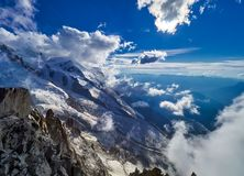 French Alps, Mont Blanc and glaciers as seen from Aiguille du Midi, Chamonix, France. French Alps, Mont Blanc and glaciers as seen from Aiguille du Midi Stock Photo