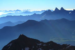 French alps panorama. Succession of peaks in the alps with a very good light Royalty Free Stock Images