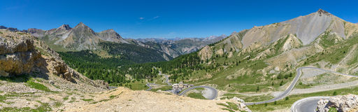 French Alps. Spectacular view of the French Alps, Napoleon mountain lodge and a winding road royalty free stock photography
