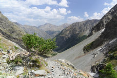 French Alps Valley. A typical French Alps valley with grass, rocks, glacier,... This valley is located in the Ecrins National Park in France near Ailefroide and Royalty Free Stock Photos