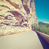 French Alps. Winding Asphalt Road in the French Alps, Instagram Effect Royalty Free Stock Photo