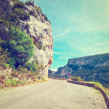 French Alps. Winding Asphalt Road in the French Alps, Instagram Effect Stock Photos