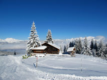 French Alps in Winter. Snow covered cabin in the French Alps royalty free stock photography